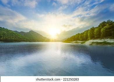 Beautiful landscape with lake at sunset