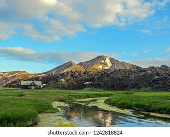 Beautiful landscape of Landmannalaugar campsite with river, green grass field and rhyolite mountains on the background, Fjallabak Nature Reserve, Highland of Iceland, Europe