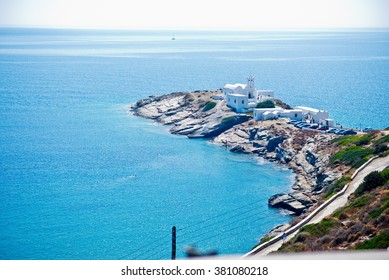 Beautiful landscape of little peninsula, with little greek church of Chrisopigi in Sifnos