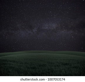 A beautiful landscape with meadow with grass  in the night with starry sky above