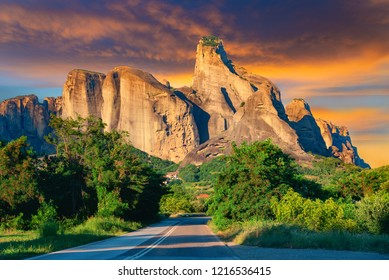 Beautiful landscape with Meteora mountain and village in sunset light - Greece