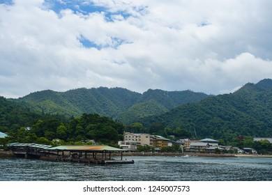Beautiful landscape of Miyajima island Port, green hills in Miyajima island, Hiroshima, Japan, 28.06.2018