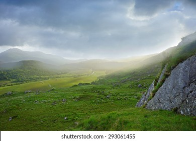 The beautiful landscape of Moll's Gap in The Ring of Kerry, Ireland, showing an early morning misty sunrise and how the clouds and shadows roll over the mountains