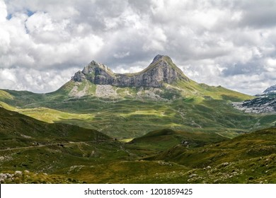 Beautiful landscape in Montenegro with fresh grass and beautiful peaks. Durmitor National Park in Montenegro part of Dinaric Alps. Durmitor Park, UNESCO World Heritage Site since 1980.