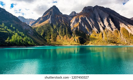 beautiful landscape of Morasco lake in high Formazza valley during the autumn season with amazing colors of water and mountains in background, Italy