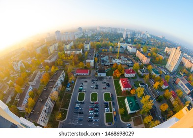 The beautiful landscape of the morning city in the rays of the rising sun, shot with a panoramic fisheye lens.