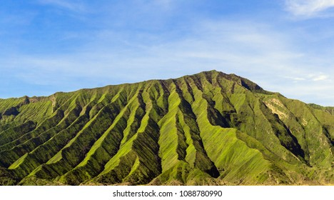 Beautiful landscape of mountain and blue sky. Panoramic view of mountain terrain and erosion the surface around the volcano at Bromo Indonesia. Texture of the earth.