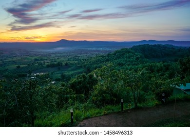 Beautiful landscape of mountain in evening with fog and sunset at Khao Takhian Ngo View Point at Khao-kho Phetchabun,Thailand. / Khao Takhian Ngo sunset at Phetchabun in Thailand.