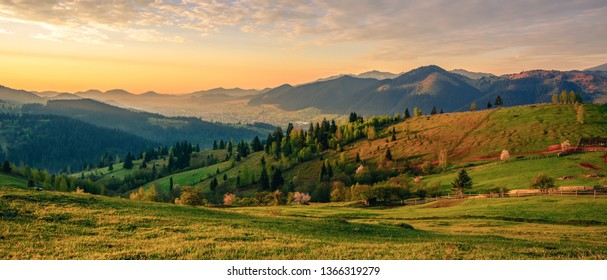 Beautiful landscape mountain hill meadow sunrise morning Bucovina village Romania