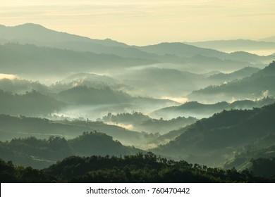 Beautiful Landscape of mountain layer in morning sun ray and winter fog at Doi Hua Mae Kham, Mae Salong Nai, Chiangrai, Thailand