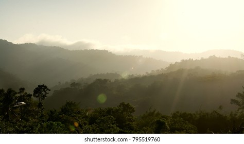Beautiful Landscape of mountain layer with sun ray and sun light flare in the morning.