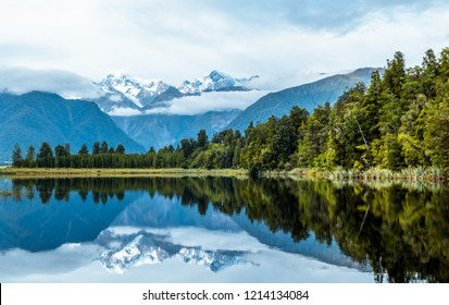 Beautiful landscape of the mountain and the reflection on the lake. Lake Matheson, Fox Glacier, New Zealand.