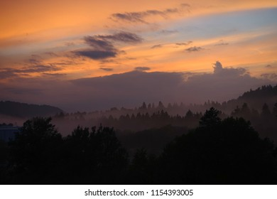 beautiful landscape with mountain view and morning fog on sunrise. natural summer background