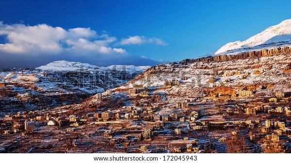 Beautiful landscape of mountainous town in winter, many cozy cottage, eco tourism, Faraya mountain in Lebanon, ski resort, wintertime holidays concept