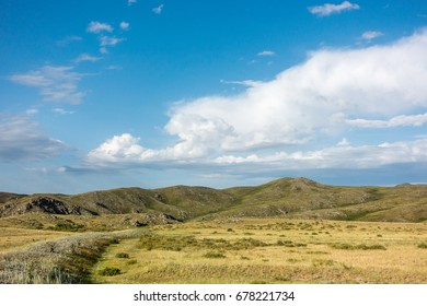 Beautiful landscape of mountains and blue sky with clouds. Eastern Kazakhstan landscape. Real scene.