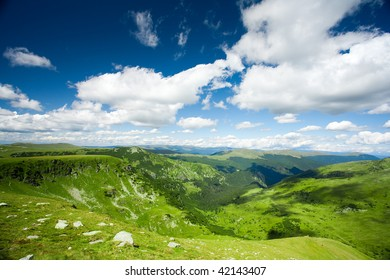 Beautiful landscape with mountains and fluffy clouds in the sky