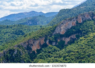 beautiful landscape of mountains and hills closeup with thickets of the wood and trees against the background of the sky