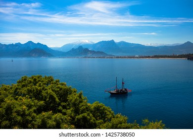 Beautiful landscape of mountains and ship in the Mediterranean sea in Turkey, Antalya.