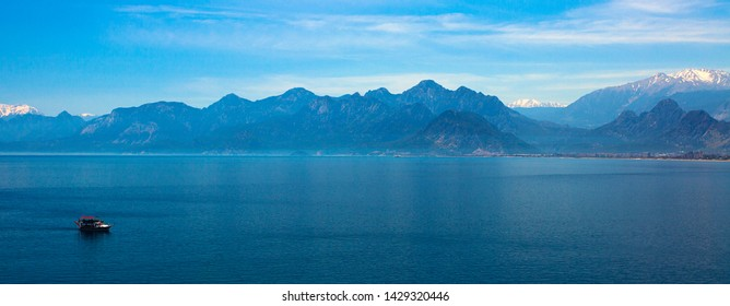Beautiful landscape of mountains and ship in the Mediterranean sea in Turkey, Antalya.Panorama