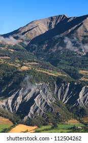 Beautiful landscape with mudslides in the bottom part, located in the Southern French Alps in The Alpes-de-Haute-Provence department.