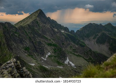 Beautiful landscape with Negoiu Peak and a dramatic sky with stormy clouds. Located in Transylvania, Romania.