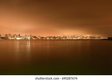 Beautiful landscape of  New York City skyline at night and representation of Hudson River like it is frozen , view from hoboken area at New Jersey