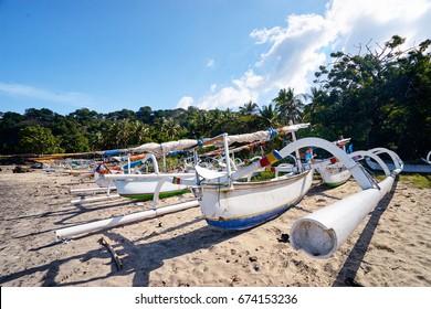 Beautiful landscape. Ocean beach and indonesian fishing boats.