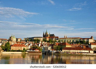 The beautiful landscape of the old town and the Hradcany (Prague Castle) with St. Vitus Cathedral and St. George church in Prague, Czech Republic.