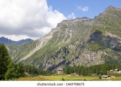 Beautiful landscape on the Alps mountain height in sunny summer season