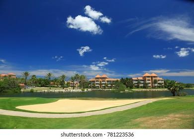 Beautiful landscape on Aruba Island. Blue sky and white clouds. Golf field. Beautiful background