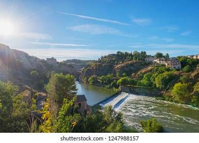 beautiful landscape on the banks of the river Tagus near the ancient Spanish city of Toledo in the rays of the morning sun