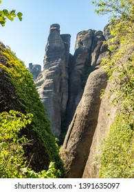 Beautiful landscape overlooking the town of Kalambaka in the valley of the river Pinyos and the rock formations in the mountains in Meteora region, Greece