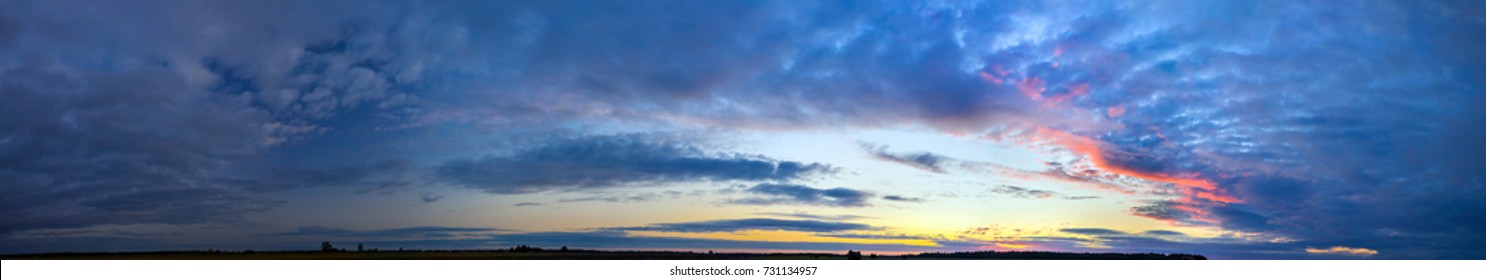 beautiful landscape panorama with blue sky, clouds and sunset. panoramic view of sunrise, a new day