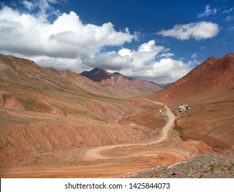 Beautiful landscape panorama of Pamir mountains area in Kyrgyzstan. Red colored mountain. Pamir highway, Roof of the world, Kyrgyzstan and Tajikistan border, m41 international road