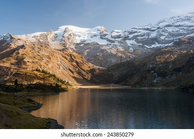 Beautiful landscape photo of mountains and lake on Trubsee / Titlis, in the Swiss Alps.