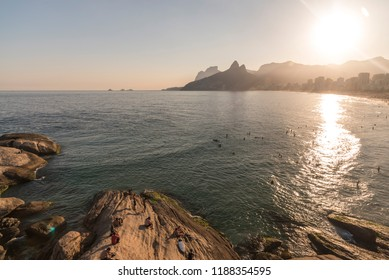 Beautiful landscape of prople watching the sunset from Arpoador Rock in Ipanema Beach, city of Rio de Janeiro, Brazil