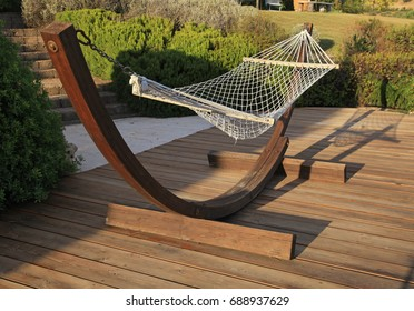 Beautiful landscape with relax hammock on wood terrace on a sunny day, Italy