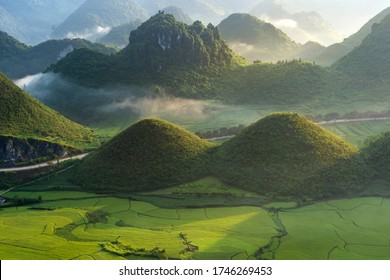 Beautiful landscape with rice paddy field of Fairy bosom or woman breasts twin mountains, Nui Doi, Double mountains is travel destination and famous place in Tam Son town, Quan Ba, Ha Giang, Vietnam
