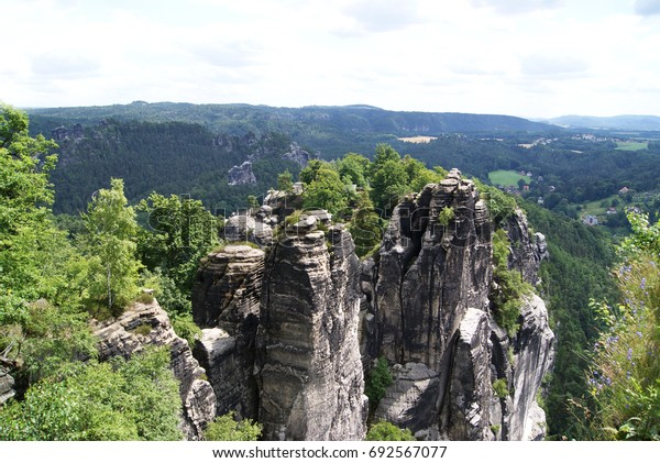 Beautiful landscape with a rock. View from the Bastei in fall at dawn, Saxon Switzerland National Park, Saxony, Germany, Europe.