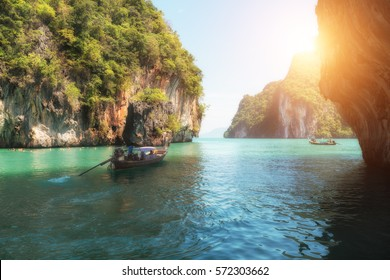 Beautiful landscape of rocks mountain and crystal clear sea with longtail boat at Phuket, Thailand. Summer, Travel, Vacation, Holiday concept.