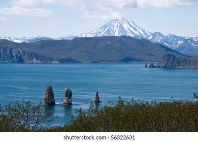 beautiful landscape with rocks and volcano on kamchatka