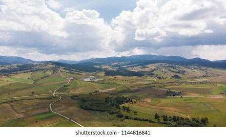 beautiful landscape with rural roads and mountains in distance