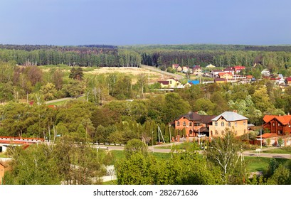 Beautiful landscape of the Russian village with forests and fields