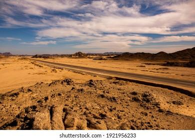 Beautiful landscape of sand dunes in Egypt. Sahara Desert. Background of orange sand wave. Africa desert