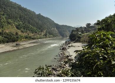 Beautiful landscape scenery through the bridge over the river. Asia, Nepal