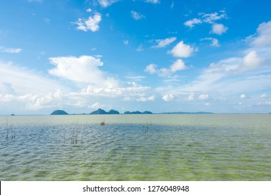 Beautiful landscape of sea with islands and blue sky with cloud, lake view point in Pak Phayun, Phatthalung province, Thailand.
