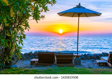 Beautiful Landscape of sea ocean on sky with umbrella and chair around there at sunset or sunrise time for leisure vacation travel concept