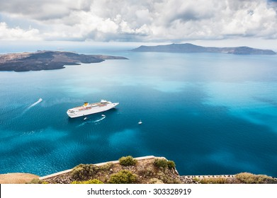 Beautiful landscape with sea view. Cruise liner at the sea near the islands. Santorini island, Greece.