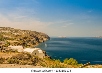 Beautiful landscape with sea view of the Nea Kameni, a small Greek island in the Aegean Sea near Santorini, Greece.