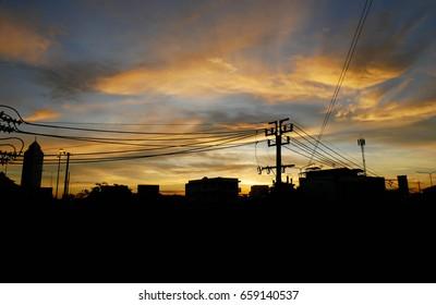 Beautiful landscape silhouettes of city. Bright orange sunset sky background.
